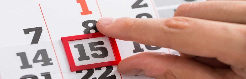 Close-up Of Person Hands Making A Red Mark On Calendar Date